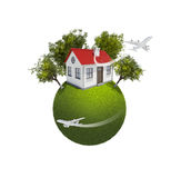 Earth with small house and trees Stock Photos