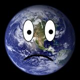 Earth smiley unhappy Royalty Free Stock Image