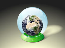 Planet Earth in snow globe Royalty Free Stock Photo