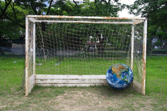 The earth on soccer goal, including elements furnished by NASA. Royalty Free Stock Photo