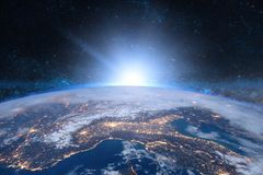 Earth in the space. Blue sunrise. Elements of this image furnished by NASA royalty free stock photography