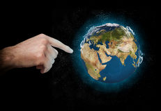 Earth in space. Hand finger touches earth in space Stock Images