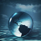 Earth sphere over ocean surface Royalty Free Stock Photography