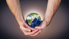 Earth spinning in mans hands Royalty Free Stock Images