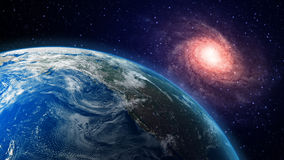 Earth and a spiral galaxy in the background