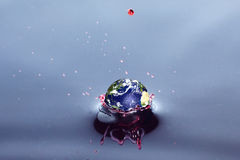 Earth in splash water Stock Image
