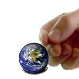 Earth on a spoon Royalty Free Stock Images