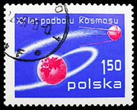 Earth and Sputnik, 60th Anniversary of the October Revolution serie, circa 1977. MOSCOW, RUSSIA - SEPTEMBER 15, 2018: A stamp printed in Poland shows Earth and stock images