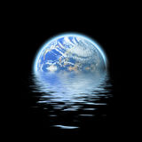Earth submerged. The earth floating in a pool of water - this works great to denote a flood or to represent the melting of the polar ice caps Royalty Free Stock Photos