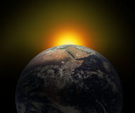 Earth and Sun Stock Images