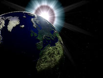 Earth with sun flare. On the background,bumps and scratches on earth surface Stock Photo