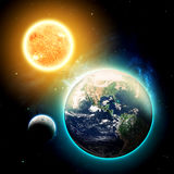 The Earth & Sun. Planet Earth & The Sun - Elements of this Image Furnished by NASA Stock Photo