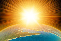 Earth and Sun. The Sun shining above the planet Earth. Aerial  view from space Stock Image