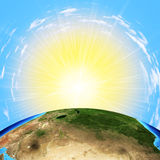 Earth with sun on sky background. Earth with sun on blue sky background. Elements of this image furnished by NASA Stock Photography