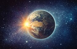 Earth, sun, star and galaxy. Sunrise over planet Earth, view fro. M space. Elements of this image furnished by NASA Stock Photo