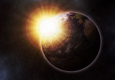 Earth at sunrise. Earth palnet as seen from space at sunrise Royalty Free Stock Images