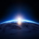 Earth sunrise over cloudy ocean with no stars. ( Elements of this image furnished by NASA - Cloudmap from http://visibleearth.nasa.gov Royalty Free Stock Photos