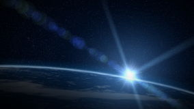 Earth sunrise. Sun rises over earth with big lens flare stock footage