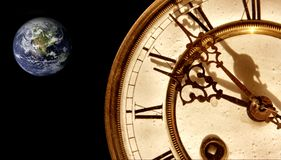 Earth time. A watch and the earth royalty free stock photos