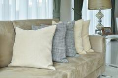 Earth tone pillows setting on light brown sofa in living roo. Earth tone pillows setting on light brown sofa in the living room stock photography