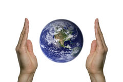 Earth between two hands 1. Two hands holding the beatifull blue earth Stock Photo