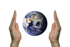 Earth between two hands 3. Two hands holding the beatifull blue earth Royalty Free Stock Image
