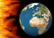 Earth under fire. Solar explosion concept - Earth isolated on black and dangerous flames Royalty Free Stock Photo