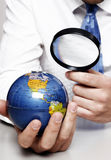 Earth under a magnifying glass Royalty Free Stock Photos