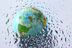 Earth under water drops Stock Image