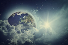 Earth view in the cloudy skies. Stock Photo