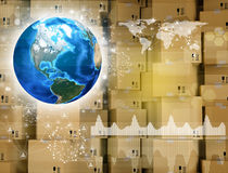 Earth and wall of cardboard boxes Royalty Free Stock Image