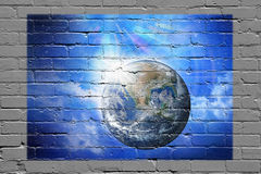 Earth Wall Graffiti Background. Graffiti of earth on a brick wall Stock Images