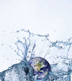 Earth in water. Planet earth in water splash Royalty Free Stock Photo