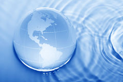 Earth in water Stock Photography
