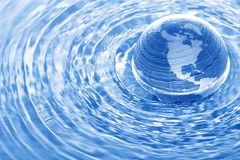 Earth in water. Glass globe in water ripples Royalty Free Stock Photos