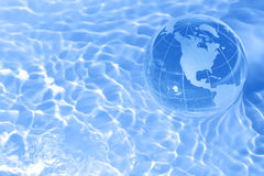 Earth in water. Earth in a pool of water Stock Photography