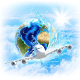 Earth with water and airplane Royalty Free Stock Photo