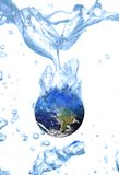 Earth  water concept global warming. Earth floating in a glass water, white background concept global warming Royalty Free Stock Photo