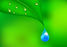 Earth in a Water Drop Background Stock Photo