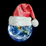 The earth is wearing a hat for christmas. Elements of this image furnished by NASA royalty free stock photos