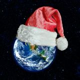 The earth is wearing a hat for christmas. Elements of this image furnished by NASA stock photos