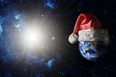 The earth is wearing a hat for christmas royalty free stock image