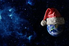 The earth is wearing a hat for christmas. Elements of this image furnished by NASA stock photo
