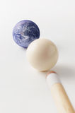 Earth and white pool balls with stick. Close-up photography Stock Photo