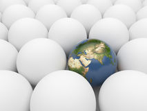 Earth  among white spheres. Unique planet. 3D Stock Photo