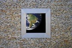 Earth Window (south america). Seeing de blue earth trough a window Stock Photo