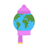 Earth winter. Planet in  knitted hat and scarf. Winter clothes Royalty Free Stock Image