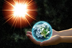 Earth in woman hands. Against open cosmos space royalty free stock images