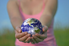 Earth is in your hands. Focused on the globe Royalty Free Stock Photos