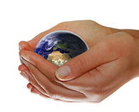 Earth in your hands stock photo